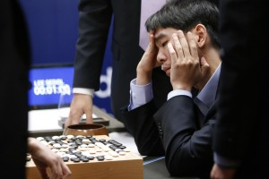 In this March 15, 2016 photo, South Korean professional Go player Lee Sedol reviews the match after finishing the final match of the Google DeepMind Challenge Match against Google's artificial intelligence program, AlphaGo, in Seoul, South Korea. Google's Go-playing computer program again defeated its human opponent in a final match on Tuesday that sealed its 4:1 victory. (AP Photo/Lee Jin-man, File)